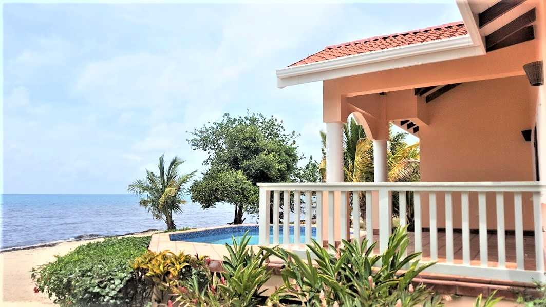 SC97: SOLD! 2 bedroom Beachfront home in Placencia with a Filled Lagoon front! Placencia Real Estate